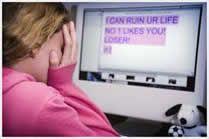 girl crying at computer screen