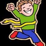Boy running through finish line