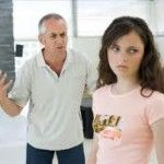 frustrated father talking at teen