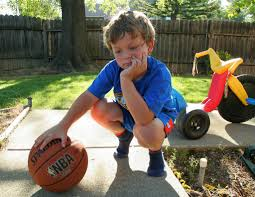 bored looking boy with basketball