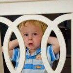 Preschooler holding ears
