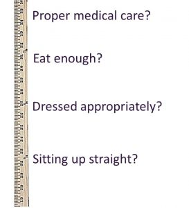 a yardstick marked with the ways people used to judge parents