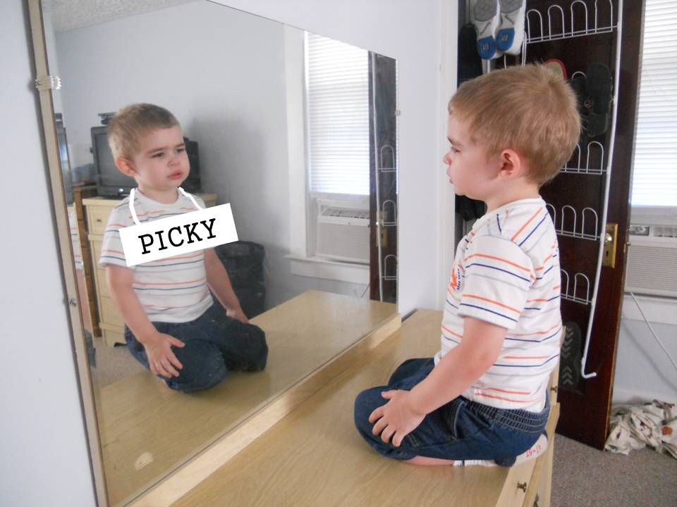 boy looking at self in mirror