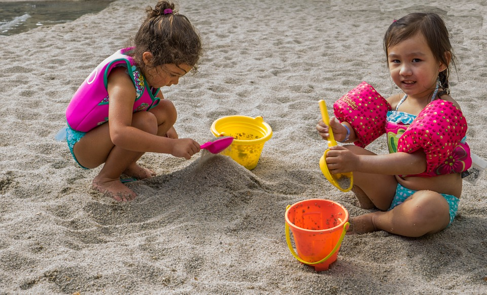children in sandbox sharing