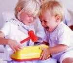 two children fighting over a toy