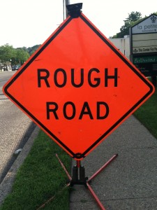 road sign saying rough road