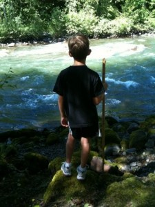 boy looking at stream