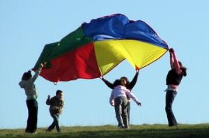 kids under a parachute