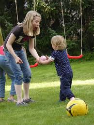 Mom and son playing ball