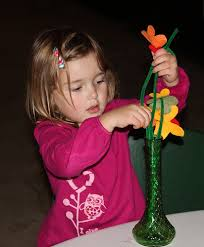 toddler playing with flowers