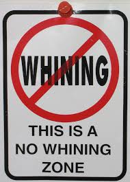 "sign saying ""This is a no whining zone"""